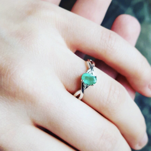 emerald engagement ring with diamond accents